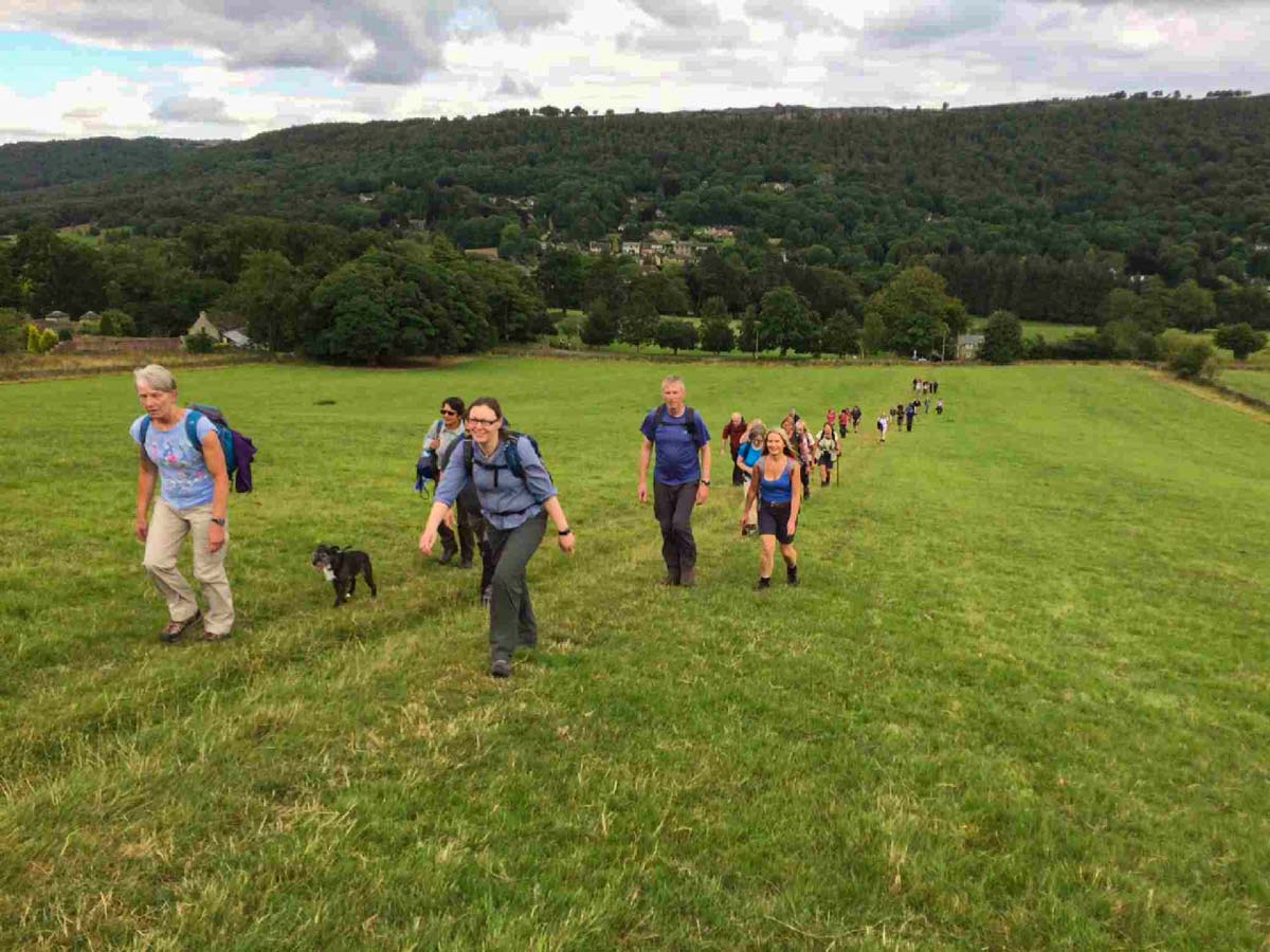 A group of walkers climbing a hill in Derbyshire